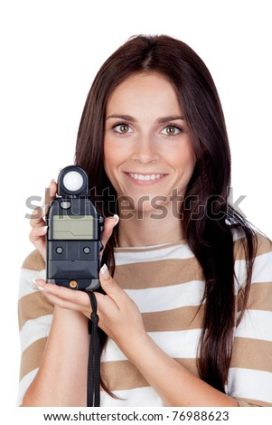 Beautiful brunette girl with a photometer isolated on a over white background - stock photo