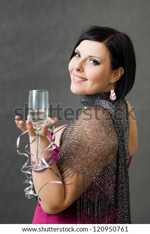 Beautiful brunette girl with glasses and sparkling wine