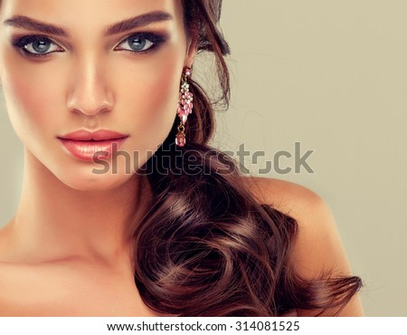 Beautiful brunette girl with hair curled tail - stock photo