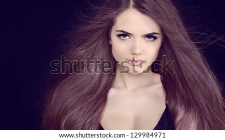 Beautiful Brunette Girl with Healthy Long Coloring Hair .