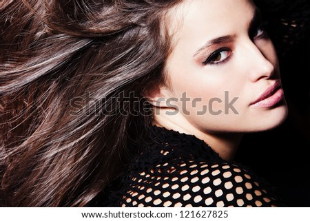 beautiful brunette girl with long healthy hair studio dark background