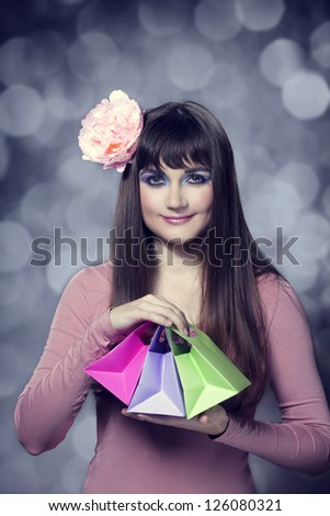 Beautiful brunette girl with present boxes - stock photo