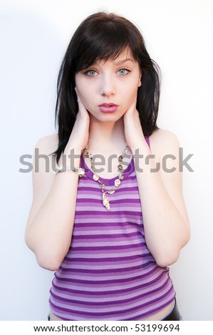 Beautiful Brunette Girl with purple camisole - stock photo