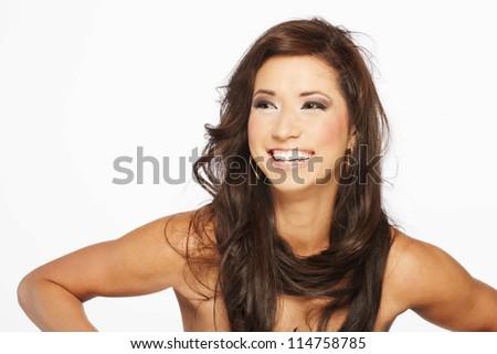 Beautiful brunette hair model in a studio environment - stock photo
