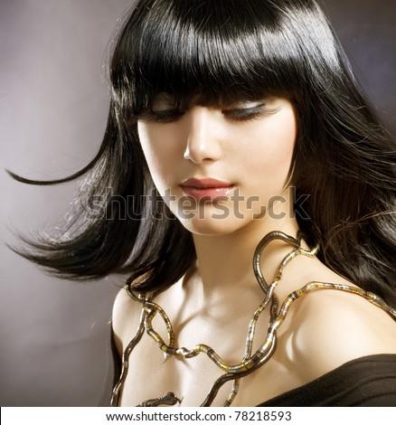 Beautiful Brunette.Hairstyle.Egyptian Style - stock photo