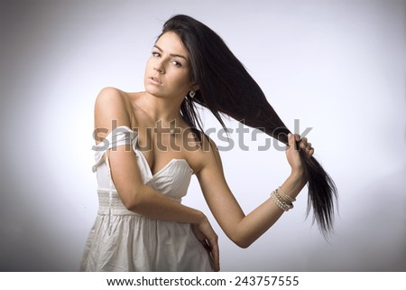 Beautiful brunette hamming for the camera - stock photo