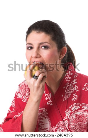 Beautiful brunette having a healthy snack on white background - stock photo