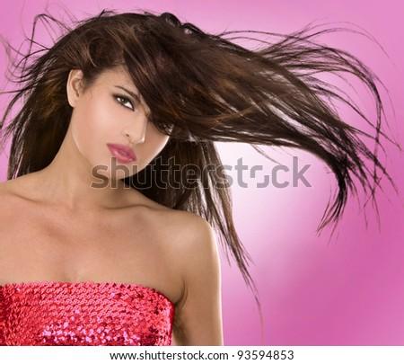 beautiful brunette having fun on pink background - stock photo