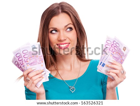 Beautiful brunette holding European money in each hand - isolated on white - stock photo