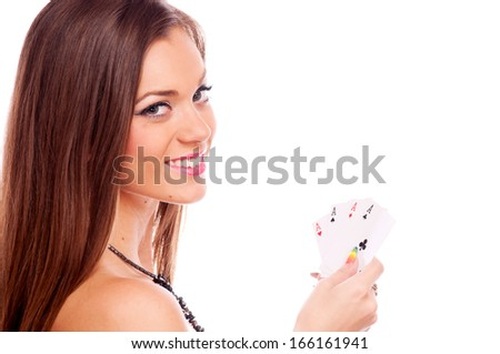 Beautiful brunette holding four aces in her hand - all aces in my hands, isolated on white  - stock photo