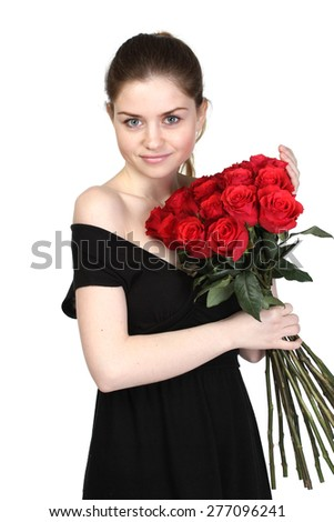 Beautiful brunette in a black dress with a large bouquet of roses - stock photo