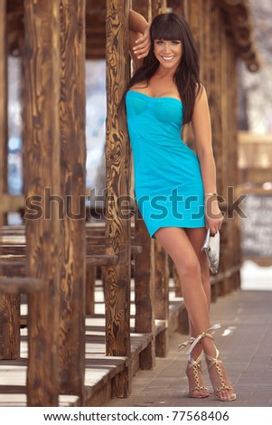 beautiful brunette in a sunny day - stock photo