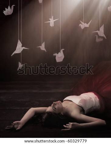 Beautiful brunette in dreamy origami - stock photo