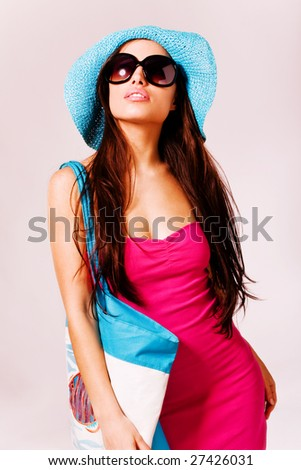 beautiful brunette in summer clothes
