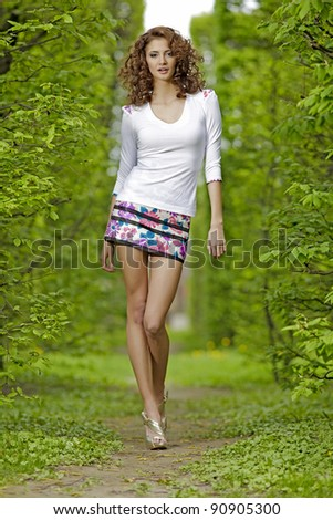 beautiful brunette in the garden - stock photo