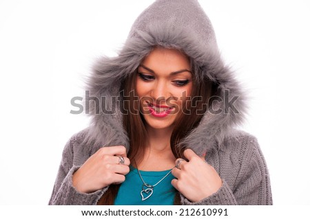 Beautiful brunette in the gray sweater with hood - isolated on white - stock photo