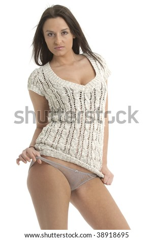 Beautiful brunette in woollen top teasing with her panties - stock photo