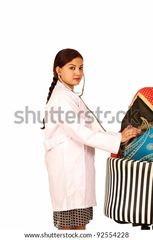 Beautiful brunette indian young happy doctor woman on surgery hospital - stock photo