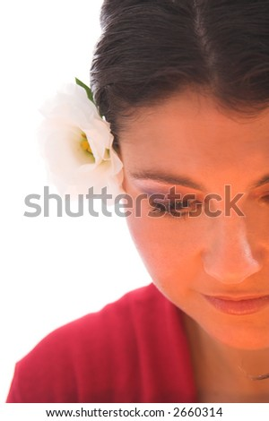 Beautiful brunette lit by candlelight on white background - stock photo