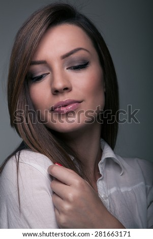 Beautiful brunette looking glamurous - stock photo