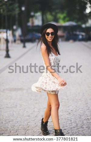 Beautiful brunette model outdoor. Street fashion photo. - stock photo