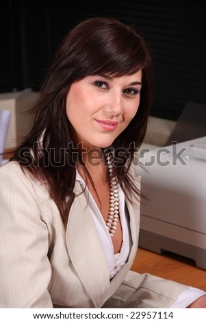 Beautiful brunette office worker at her desk