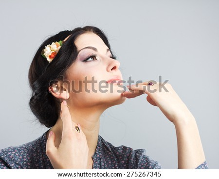 Beautiful brunette on a gray background.Beautiful girl with the Greek haircut. Provence style - stock photo