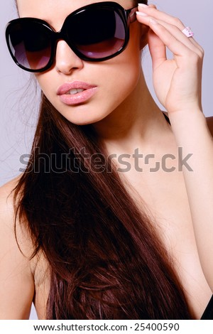 beautiful brunette portrait with sunglasses - stock photo