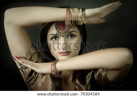 Beautiful brunette portrait with traditional costume. Indian style