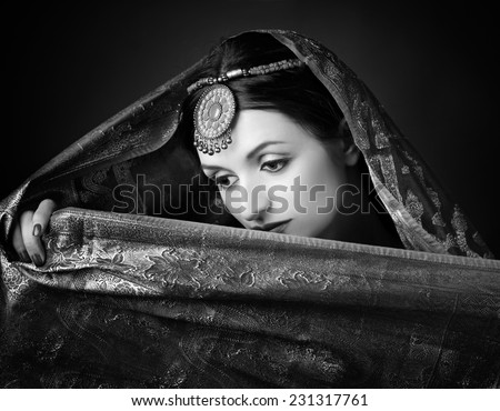 Beautiful brunette portrait with traditional  indian costume.  - stock photo