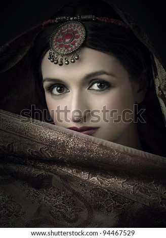 Beautiful brunette portrait with traditional indian costume - stock photo