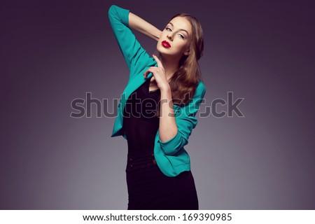 Beautiful brunette posing in green jacket. Red lips. Studio  - stock photo