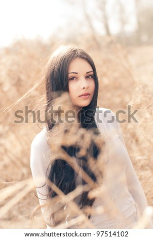 beautiful brunette posing in the sunny day - stock photo