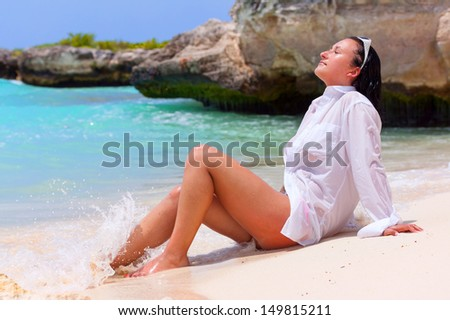 Beautiful brunette posing on the beach of Caribbean Sea