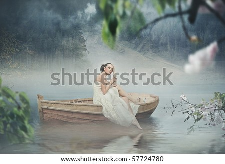 Beautiful brunette posing over beautiful romantic landscape - stock photo
