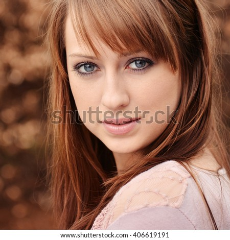 beautiful brunette posing over brown background