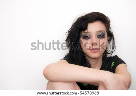 Beautiful Brunette Rocker Girl crying - stock photo