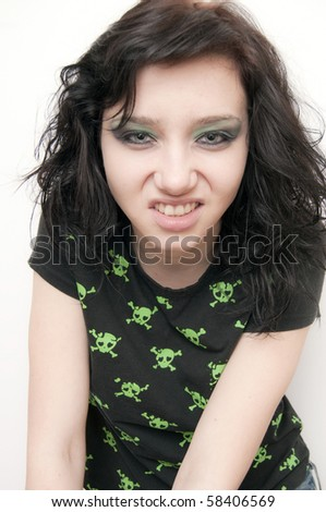 Beautiful Brunette Rocker Girl nervous - stock photo