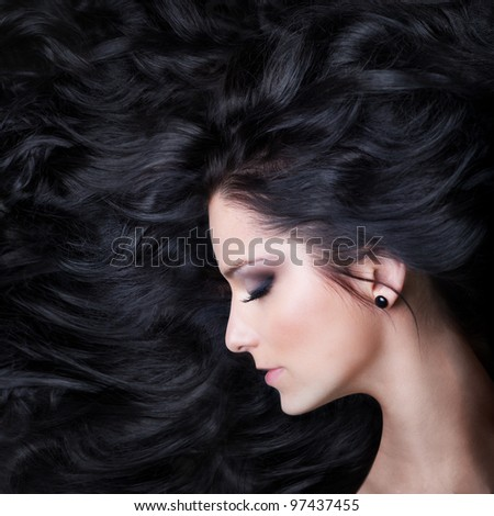 Beautiful Brunette Sleeping. Healthy Curly Long Hair - stock photo