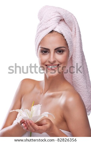 Beautiful brunette spa woman in the morning in towel on head