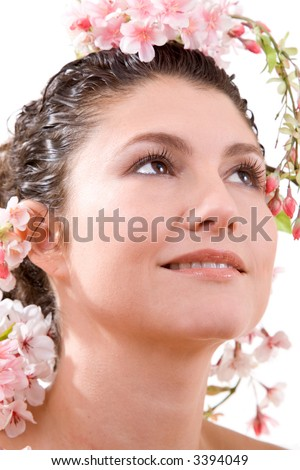 beautiful brunette surrounded by blossom flowers on white background - stock photo