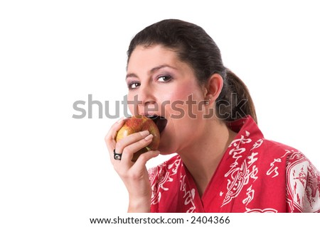 beautiful brunette taking a big bite out of a healthy apple - stock photo