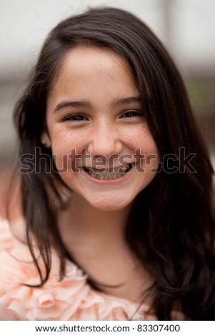 Beautiful brunette teenage girl. Nice bokeh. Very shallow depth of field. - stock photo