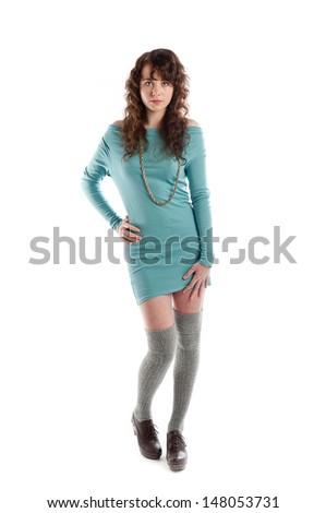 Beautiful brunette teenage girl wearing turquoise and posing in the studio - stock photo