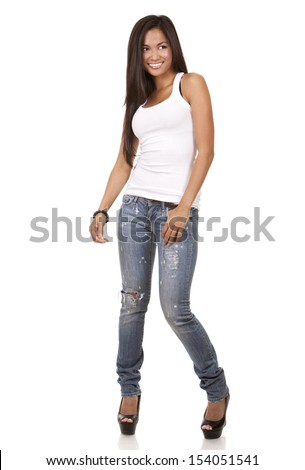 beautiful brunette wearing white top and jeans on light background - stock photo