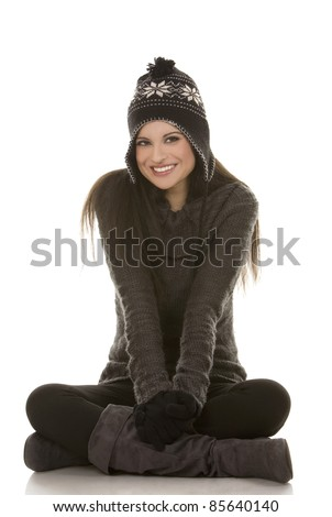 beautiful brunette wearing winter outfit on white background - stock photo