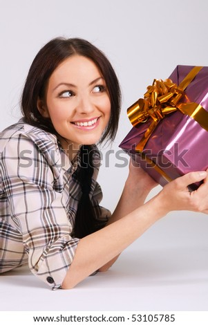 Beautiful brunette with a gift box - stock photo
