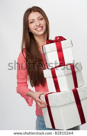 Beautiful brunette with a gift boxes. - stock photo