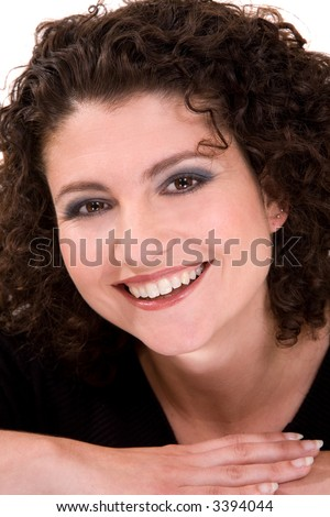 beautiful brunette with a gorgeous smile and curly hair - stock photo