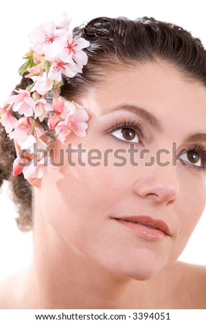 Beautiful brunette with blossom flowers in her hair on white background - stock photo